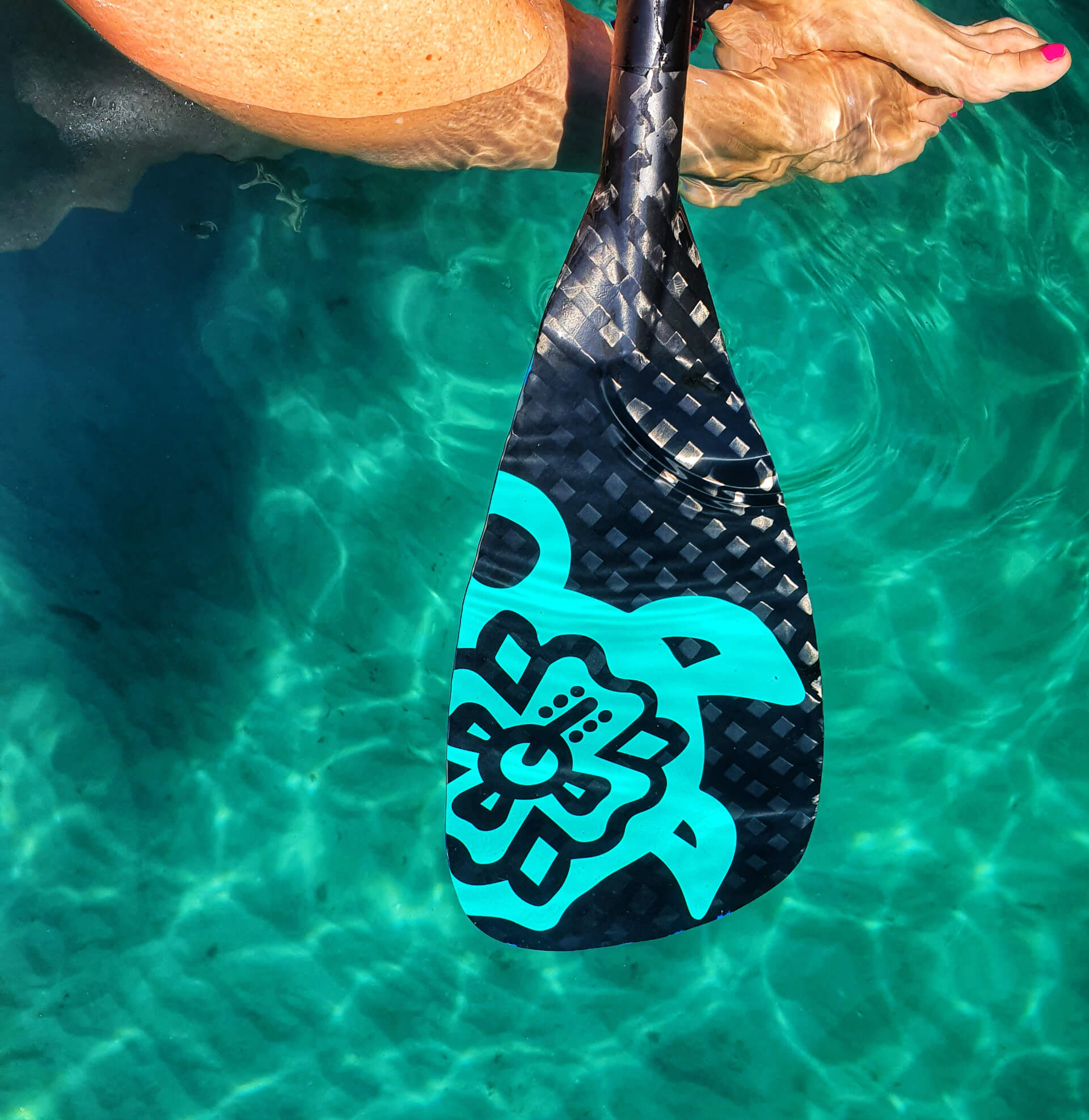 Carey Surf Paddle Hoe Custom Paddle under crystal clear water