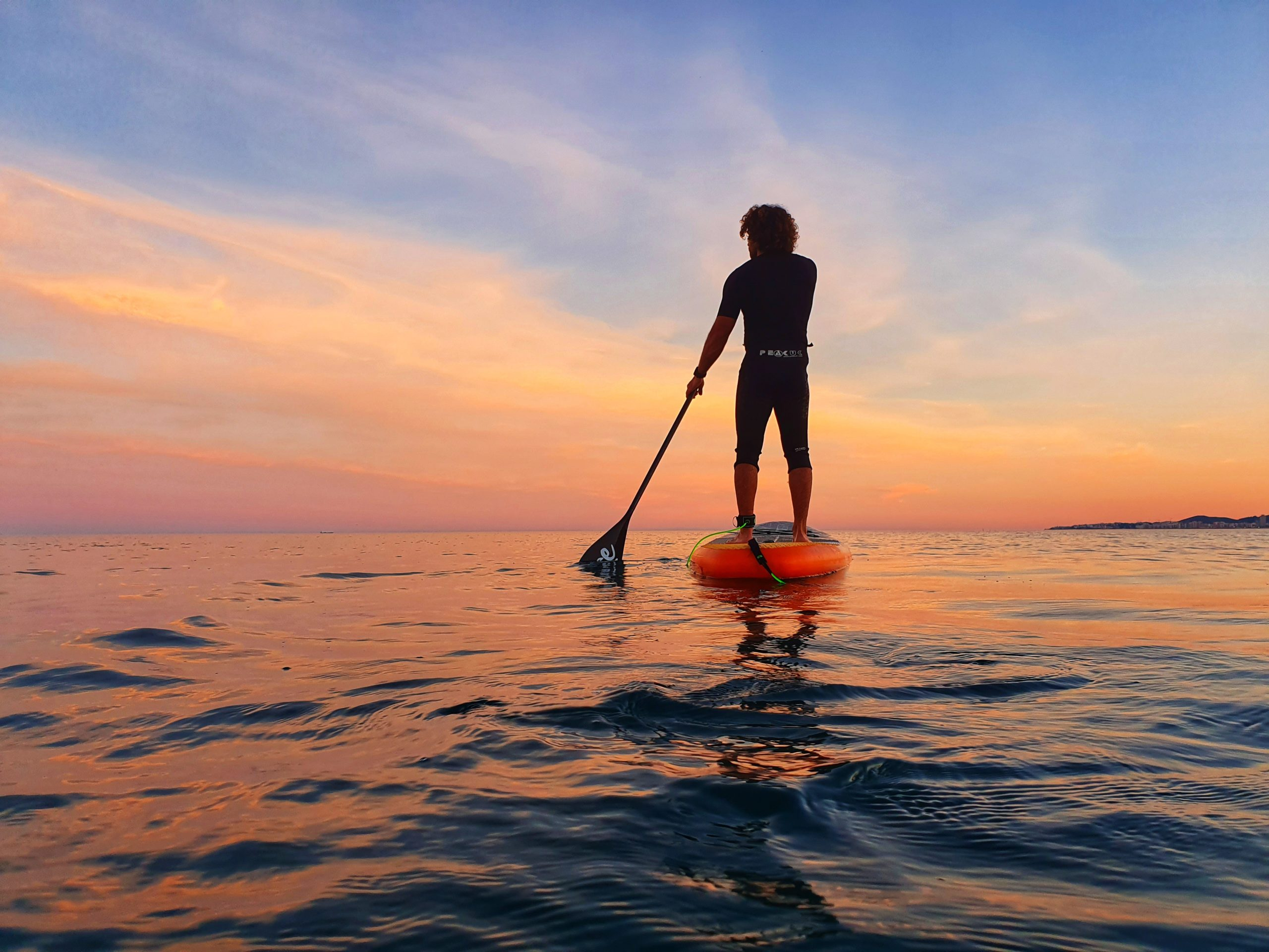 hoe sunset paddle surf